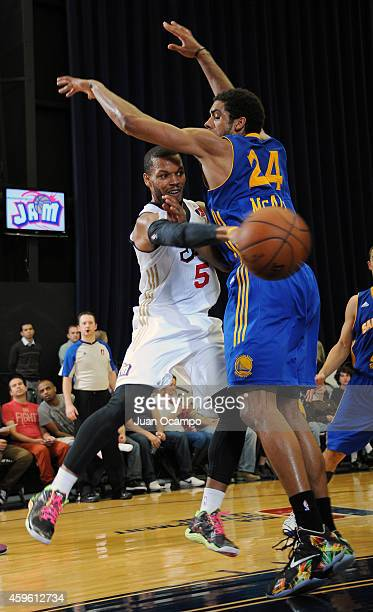Chris Wright of the Bakersfield Jam makes a pass against James Michael McAdoo of the Santa Cruz Warriors during a DLeague game on November 25 2014 at...