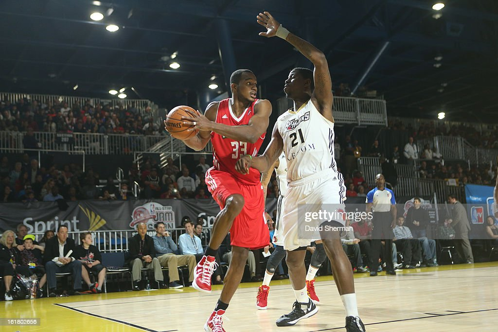 Chris Wright #33 of the Futures team drives against Arinze Onuaku #21 of the Prospects team during the 2013 NBA D-League All-Star Game in Sprint Arena at Jam Session during NBA All Star Weekend on February 16, 2013 at the George R. Brown in Houston, Texas.