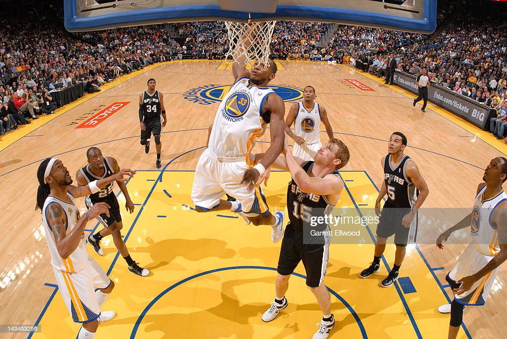 Chris Wright #33 of the Golden State Warriors dunks against Matt Bonner #15 of the San Antonio Spurs on April 26, 2012 at Oracle Arena in Oakland, California.