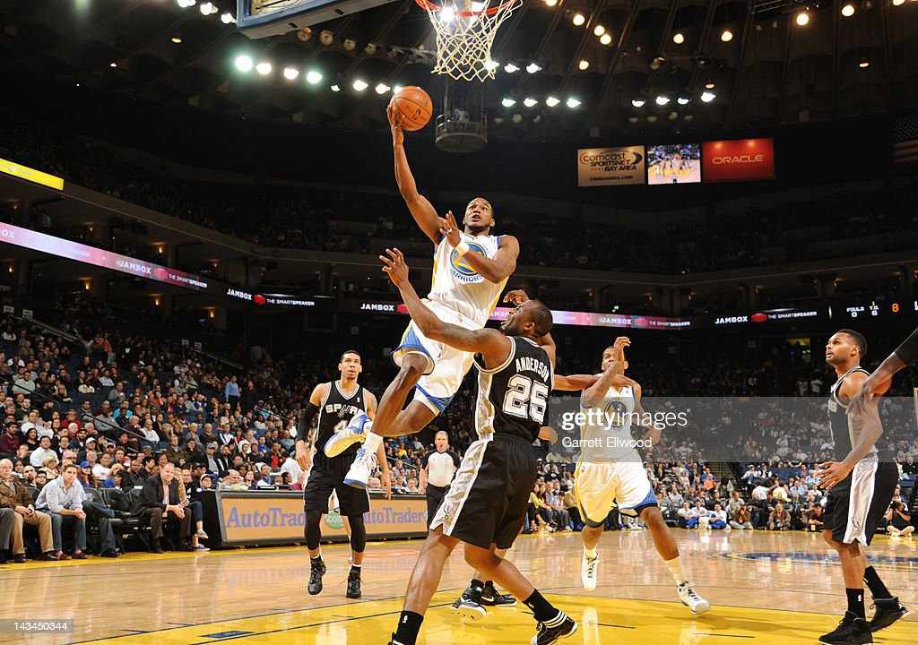 Chris Wright #33 of the Golden State Warriors goes for a layup against James Anderson #25 of the San Antonio Spurs on April 26, 2012 at Oracle Arena in Oakland, California.