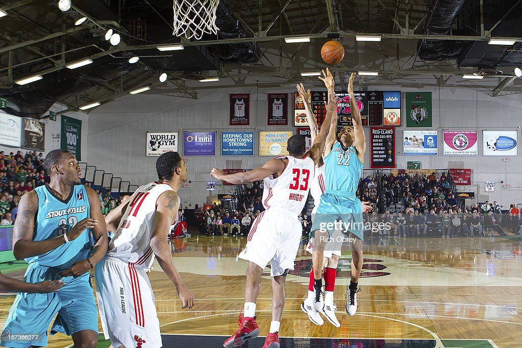 Chris Wright #33 of the Maine Red Claws defends against a shot by Dan Coleman #22 of the Sioux Falls Skyforce on December 2, 2012 at the Portland Expo in Portland, Maine.