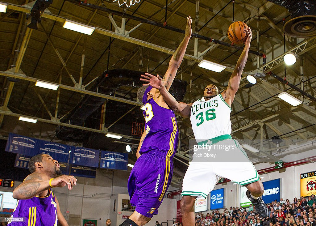 Chris Wright #33 of the Maine Red Claws shoots around Jamario Moon #33 of the Los Angeles D-Fenders on November 30, 2012 at the Portland Expo in Portland, Maine.