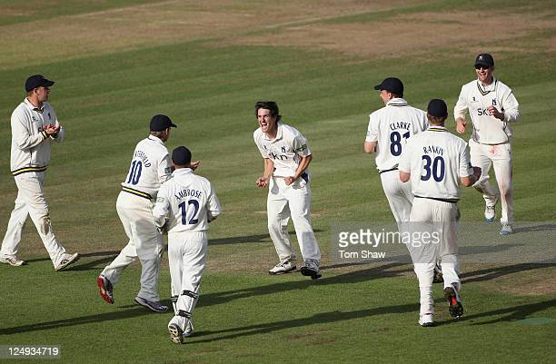 Chris Wright of Warwickshire celebrates taking the wicket of James Tomlinson of Hampshire during the LV County Championship match between Hampshire...