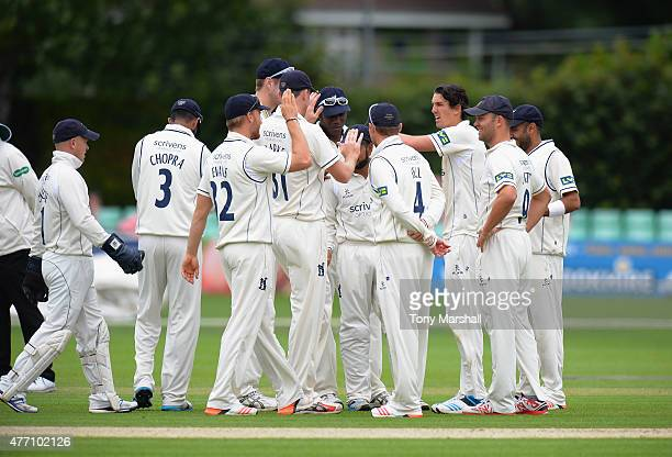 Chris Wright of Warwickshire celebrates with his teammates after taking the wicket of Daryl Mitchell of Worcestershire during the LV County...