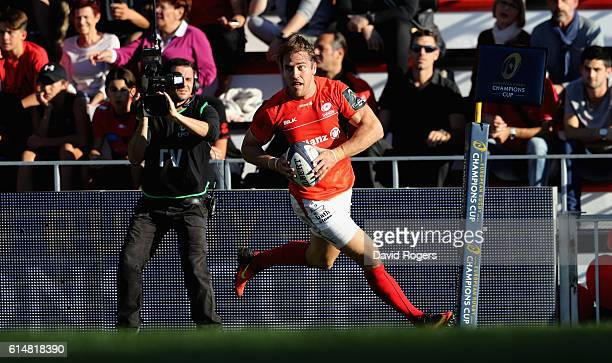 Chris Wyles of Saracens breaks clear to score their third try during the European Rugby Champions Cup match between RC Toulon and Saracens at Stade...