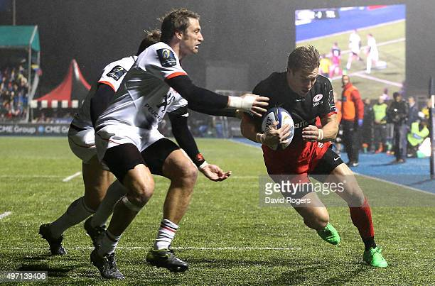 Chris Wyles of Saracens evades the challenge from Maxime Medard to score the second try during the European Rugby Champions Cup match between...