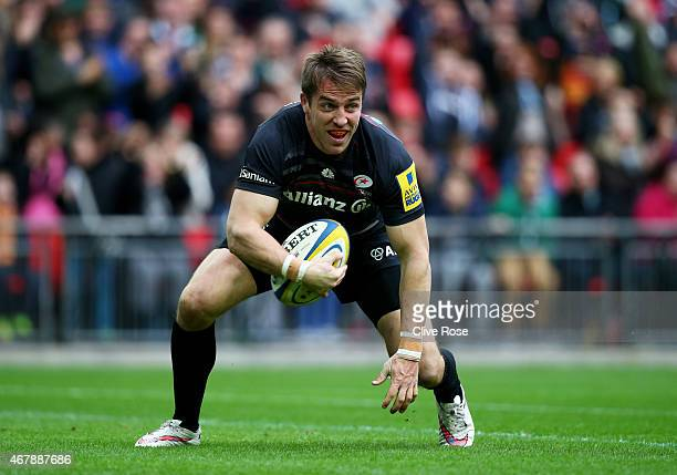 Chris Wyles of Saracens goes over to score his team's first try during the Aviva Premiership match between Saracens and Harlequins at Wembley Stadium...