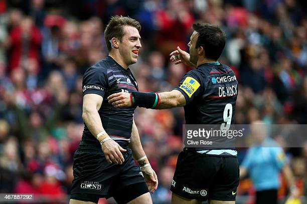 Chris Wyles of Saracens is congratulated by teammate Neil de Kock of Saracens after scoring his team's first try during the Aviva Premiership match...