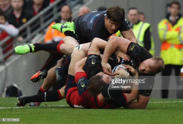 Chris Wyles of Saracens rolls over to score their second try during the European Rugby Champions Cup semi final match between Munster and Saracens at...