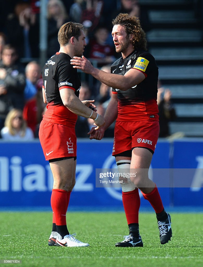 <a gi-track='captionPersonalityLinkClicked' href=/galleries/search?phrase=Chris+Wyles&family=editorial&specificpeople=764213 ng-click='$event.stopPropagation()'>Chris Wyles</a> of Saracens shakes the hand of <a gi-track='captionPersonalityLinkClicked' href=/galleries/search?phrase=Jacques+Burger&family=editorial&specificpeople=4017985 ng-click='$event.stopPropagation()'>Jacques Burger</a> of Saracens as he walks off in his last match during the Aviva Premiership match between Saracens and Newcastle Falcons at Allianz Park on May 1, 2016 in Barnet, England.