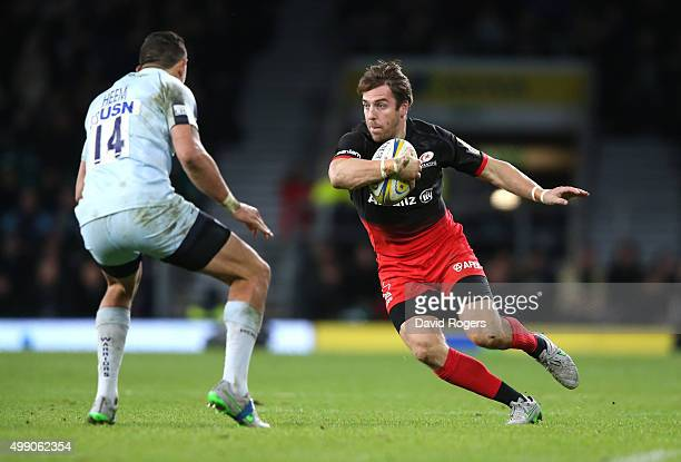 Chris Wyles of Saracens takes on Phil Dowson during the Aviva Premiership match between Saracens and Worcester Warriors at Twickenham Stadium on...