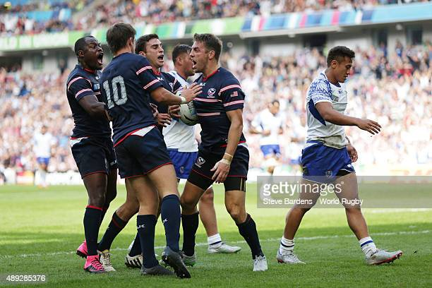 Chris Wyles of the United States celebrates scoring his teams opening try with team mates during the 2015 Rugby World Cup Pool B match between Samoa...