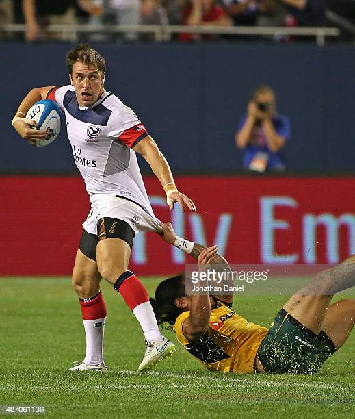 Chris Wyles of the United States Eagles is hauled down by Joe Tomane of Australia Wallabies during a match at Soldier Field on September 5 2015 in...