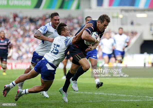 Chris Wyles of the United States is tackled by Tim NanaiWilliams of Samoa as he breaks clear to score his teams opening try during the 2015 Rugby...