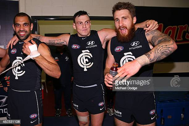 Chris Yarran Mitch Robinson and Zac Tuohy of the Blues celebrate their win during the round 18 AFL match between the Carlton Blues and the North...