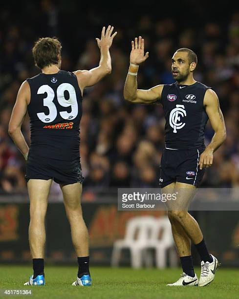 Chris Yarran of the Blues celebrates with Dale Thomas after kicking a goal during the round 16 AFL match between the Carlton Blues and the St Kilda...