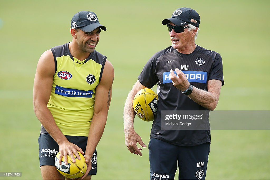 Chris Yarran reacs to coach Michael Malthouse during a Carlton Blues AFL training session at Visy Park on March 15, 2014 in Melbourne, Australia.