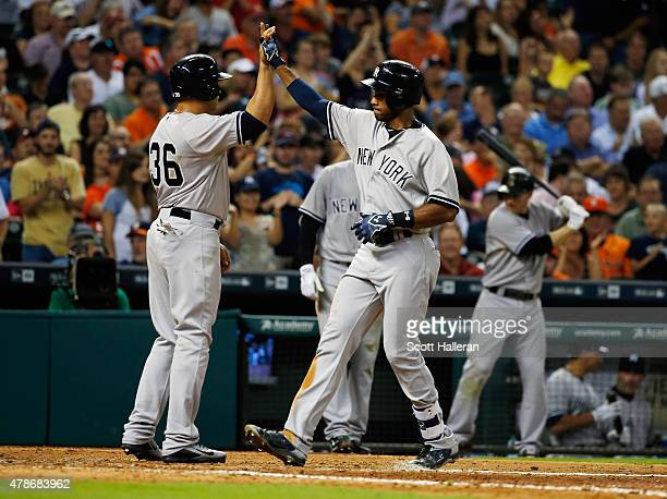 Chris Young and Carlos Beltran of the New York Yankees celebrate after Young hit a threerun home run in the seventh inning during their game against...