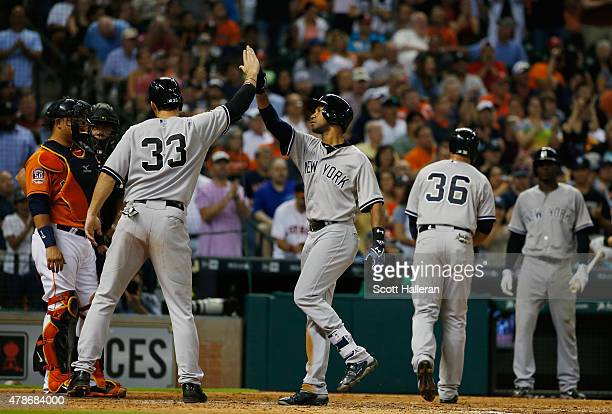 Chris Young and Garrett Jones of the New York Yankees celebrate after Young hit a threerun home run in the seventh inning during their game against...