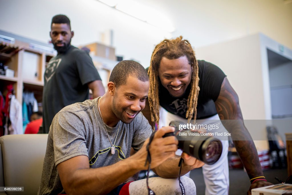 Chris Young #30 and Hanley Ramirez #13 of the Boston Red Sox use a camera before a Spring Training game against the New York Yankees on February 28, 2017 at Fenway South in Fort Myers, Florida .