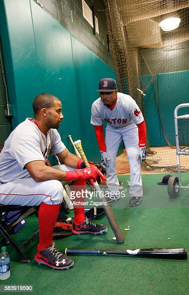 Chris Young and Mookie Betts of the Boston Red Sox talk in the indoor batting cage prior to the game against the San Francisco Giants at ATT Park on...