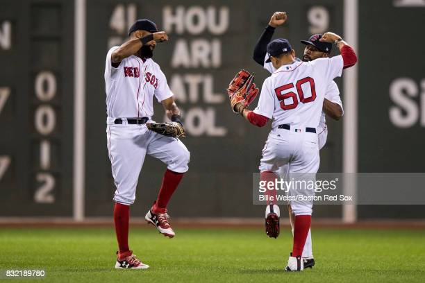Chris Young Jackie Bradley Jr #19 and Mookie Betts of the Boston Red Sox celebrate a victory against the St Louis Cardinals on August 15 2017 at...