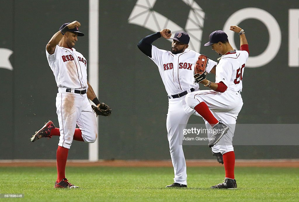 Chris Young Jackie Bradley Jr #25 and Mookie Betts of Boston Red Sox celebrate after their victory over the Tampa Bay Rays at Fenway Park on August...