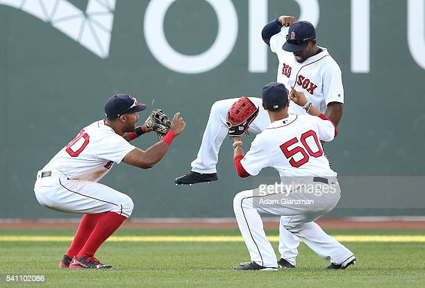 Chris Young Jackie Bradley Jr #25 and Mookie Betts of the Boston Red Sox celebrate after their victory over the Seattle Mariners at Fenway Park on...