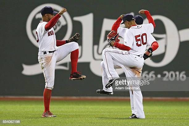 Chris Young Mookie Betts and Jackie Bradley Jr #25 of the Boston Red Sox celebrate after a victory over the Colorado Rockies at Fenway Park on May 24...