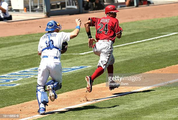 Chris Young of the Arizona Diamondbacks is caught in a rundown as he is chased back towards third by catcher Matt Treanor of the Los Angeles Dodgers...