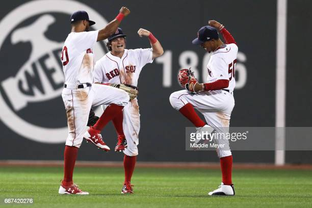 Chris Young of the Boston Red Sox Andrew Benintendi and Mookie Betts celebrate their 81 win over the Baltimore Orioles at Fenway Park on April 11...