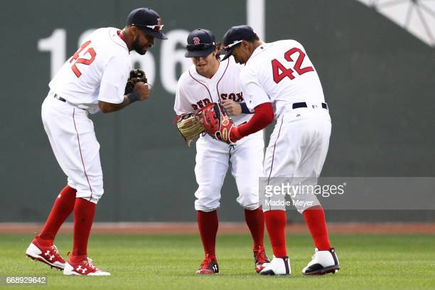 Chris Young of the Boston Red Sox Andrew Benintendi and Mookie Betts celebrate after defeating the Tampa Bay Rays 21 at Fenway Park on April 15 2017...