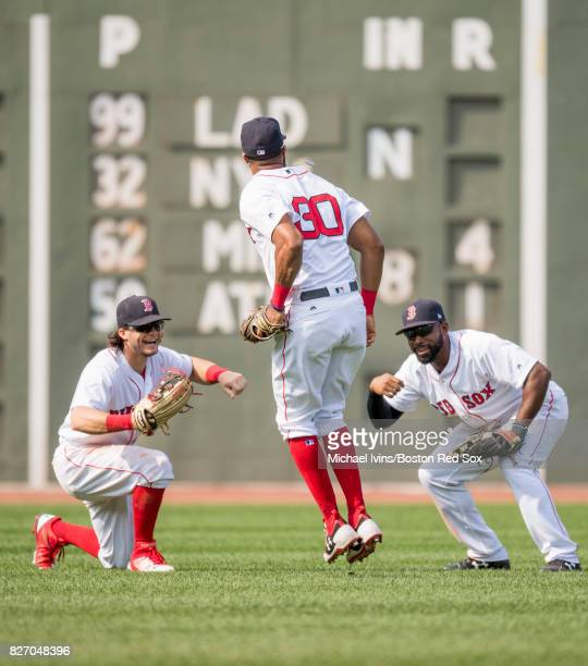Chris Young of the Boston Red Sox celebrates after a 63 win over the Chicago White Sox with Andrew Benintendi and Jackie Bradley Jr #30 on August 6...