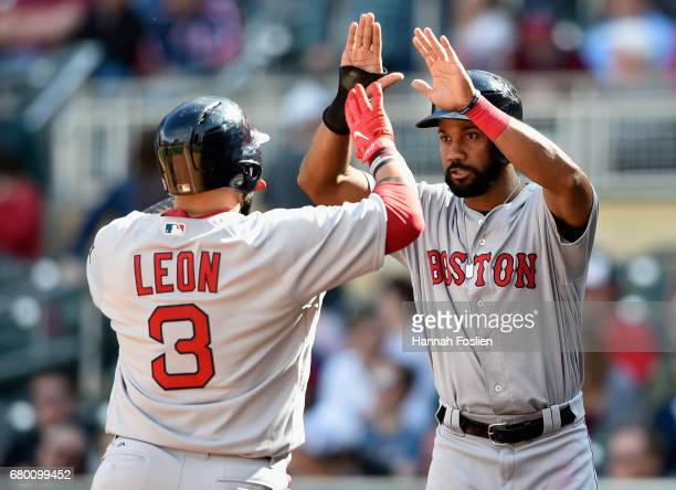 Chris Young of the Boston Red Sox congratulates teammate Sandy Leon on a tworun home run against the Minnesota Twins during the ninth inning of the...