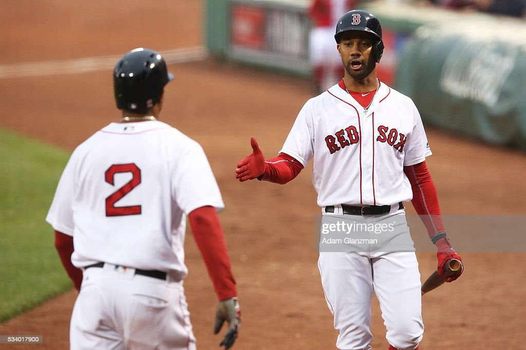 Chris Young #30 of the Boston Red Sox congratulates Xander Bogaerts #2 on scoring on his way back to the dugout in the first inning during the game against the Colorado Rockies at Fenway Park on May 24, 2016 in Boston, Massachusetts.