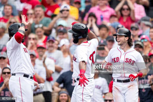 Chris Young of the Boston Red Sox high fives Andrew Benintendi and Sandy Leon after hitting a three run home run during the fifth inning of a game...