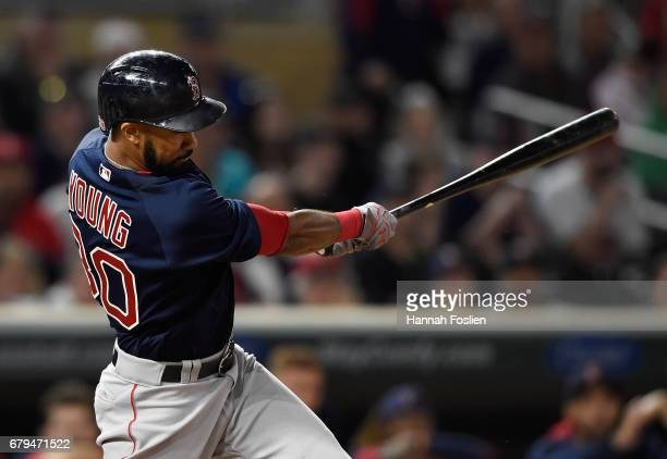 Chris Young of the Boston Red Sox hits a tworun single against the Minnesota Twins during the ninth inning of the game on May 5 2017 at Target Field...