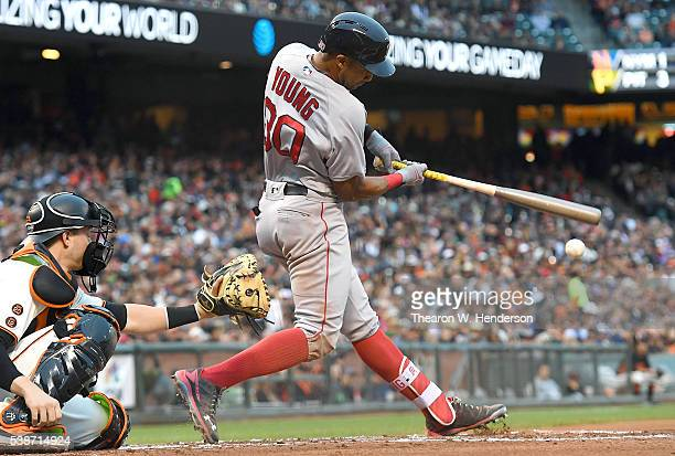 Chris Young of the Boston Red Sox hits an rbi double scoring Jackie Bradley Jr #25 against the San Francisco Giants in the top of the second inning...