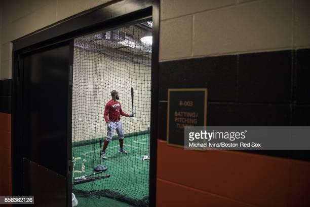 Chris Young of the Boston Red Sox hits in the batting cage before game two of the American League Division Series against the Houston Astros at...