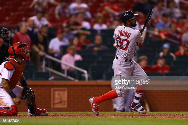 Chris Young of the Boston Red Sox hits the gamewinning RBI single against the St Louis Cardinals in the 13th inning at Busch Stadium on May 17 2017...