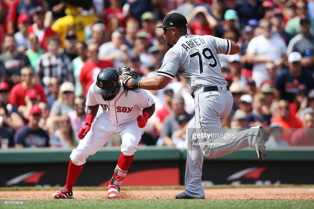 Chris Young #30 of the Boston Red Sox is tagged out by Jose Abreu #79 of the Chicago White Sox during the third inning at Fenway Park on August 6, 2017 in Boston, Massachusetts.