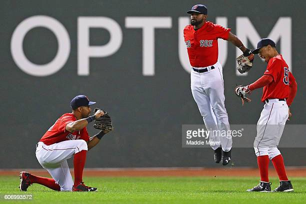 Chris Young of the Boston Red Sox Jackie Bradley Jr #25 and Mookie Betts celebrate their 74 win over the New York Yankees at Fenway Park on September...
