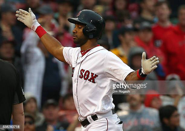 Chris Young of the Boston Red Sox reacts after his home run against Marco Estrada of the Toronto Blue Jays in the eighth inning to break up a...
