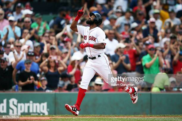 Chris Young of the Boston Red Sox reacts as he rounds the bases after hitting a threerun home run in the fifth inning of a game against the Chicago...