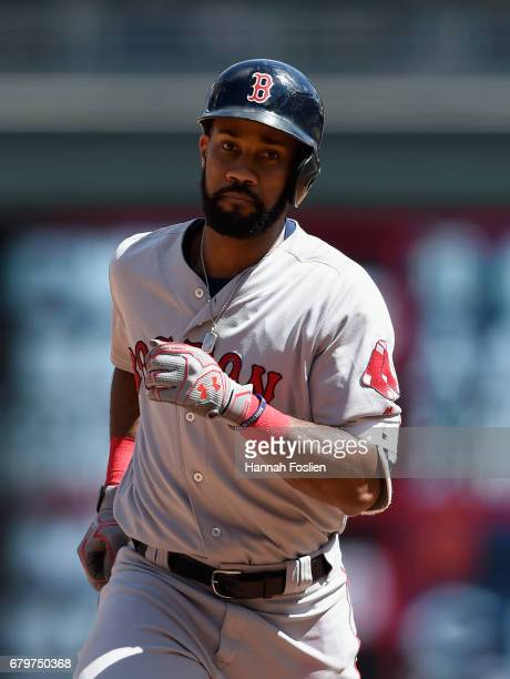 Chris Young of the Boston Red Sox rounds the bases after hitting a solo home run against the Minnesota Twins during the fifth inning of the game on...