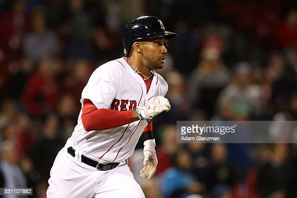 Chris Young of the Boston Red Sox runs to first base in the seventh inning during the game at Fenway Park on May 9 2016 in Boston Massachusetts