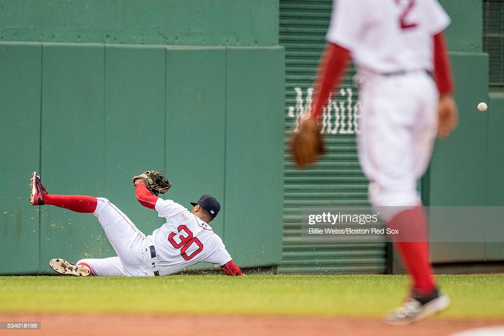 Chris Young #30 of the Boston Red Sox slides as he misses a line drive during the second inning of a game against the Colorado Rockies on May 24, 2016 at Fenway Park in Boston, Massachusetts.