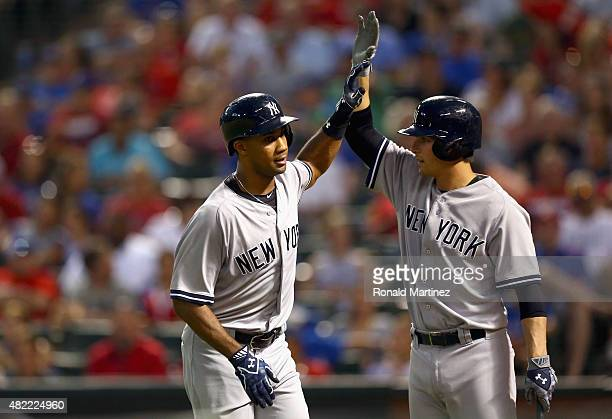 Chris Young of the New York Yankees celebrates his grand slam with John Ryan Murphy in the third inning against the Texas Rangers at Globe Life Park...