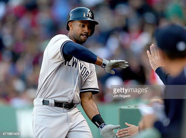 Chris Young of the New York Yankees celebrates his home run in the ninth inning against the Boston Red Soxat Fenway Park May 2 2015 in Boston...