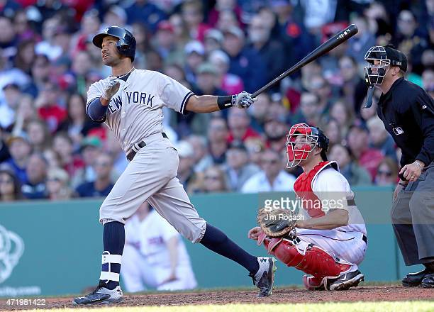 Chris Young of the New York Yankees hits a home run in the ninth inning against the Boston Red Soxat Fenway Park May 2 2015 in Boston Massachusetts A...